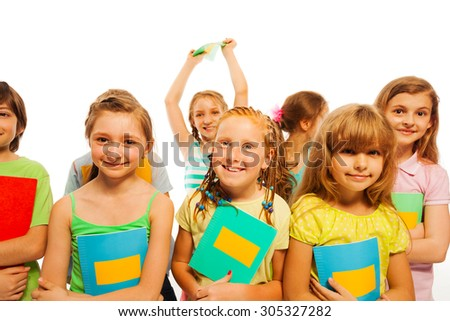 Smiling girls and boys holding textbooks