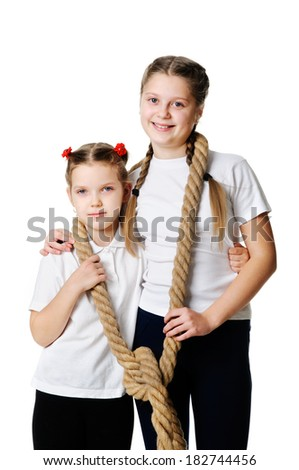 Smiling girls holding a rope.