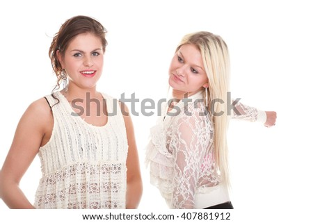 Smiling girls portrait of two women isolated on white