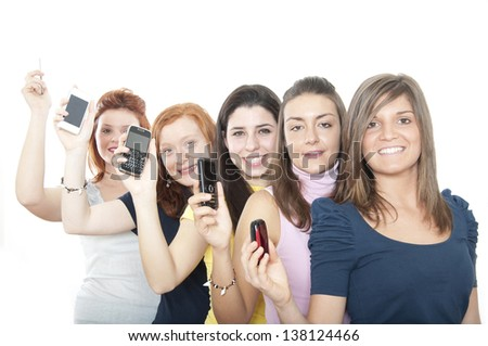 Smiling girls with smartphones. - stock photo