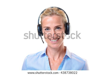 Smiling gorgeous short haired blond adult woman in blue blouse with telephone headset working as a customer service representative over white background - stock photo
