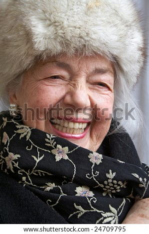 Smiling grandmother with fur - stock photo