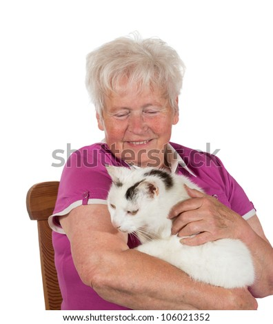 Smiling granny sitting on chair and holding her cat - isolated on white - stock photo