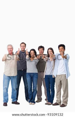 Smiling group giving thumbs up against a white background - stock photo
