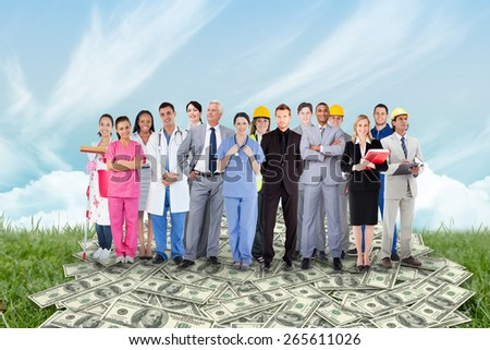 Smiling group of people with different jobs against field and sky - stock photo