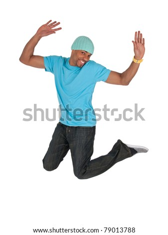Smiling guy in a blue t-shirt jumping for joy, isolated on white background. - stock photo