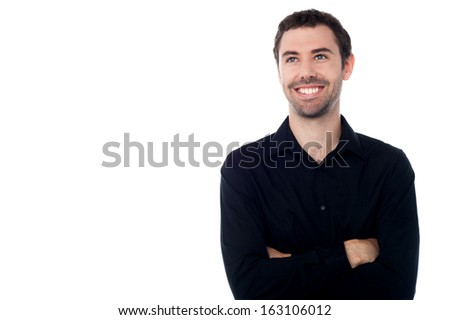 Smiling guy lost in his own world - stock photo
