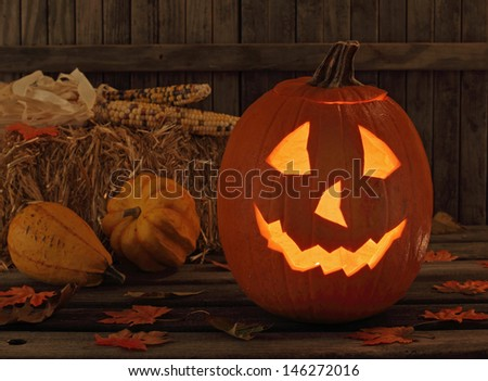 Smiling halloween jack-o-lantern in a rustic setting - stock photo