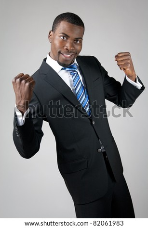 Smiling handsome African American businessman showing his strength.