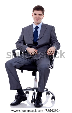 Smiling, handsome business man. Seating on chair. Looking at camera. White background - stock photo
