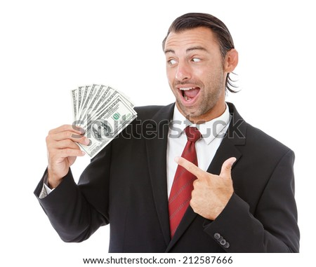 Smiling handsome businessman holding money isolated on white background. - stock photo