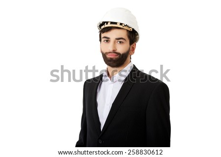 Smiling handsome businessman with hard hat. - stock photo