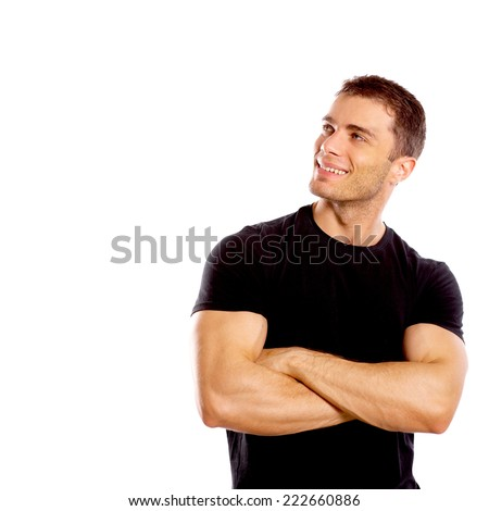 Smiling handsome confident young man standing with folded arms looking to the side  isolated on white - stock photo