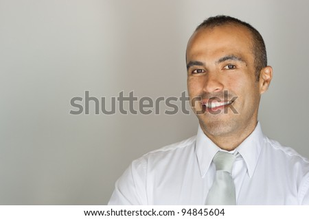 Smiling Handsome Latin Guy in tie - stock photo