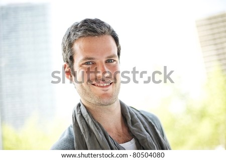 Smiling handsome man outdoors - stock photo