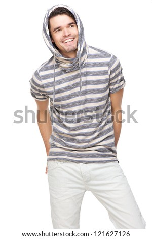Smiling handsome man with hood over his head. Fashion model has hands in back pocket and wearing a striped hooded sweatshirt. Isolated on white background - stock photo