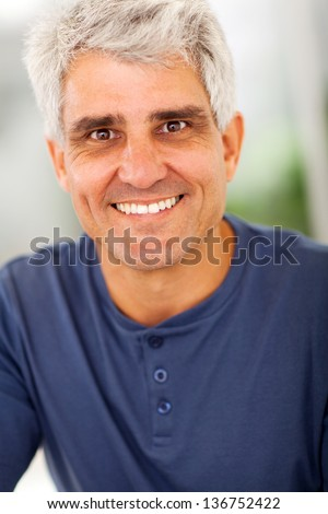smiling handsome mature man portrait at home - stock photo