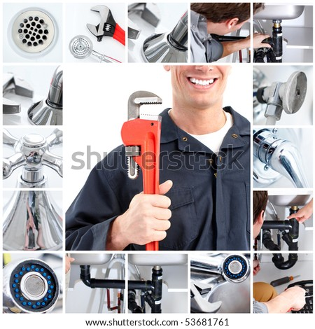 Smiling handsome plumber with an adjustable wrench