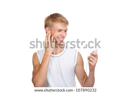 Smiling handsome young guy listening to music songs on the mp3 player, man wear white t shirt isolated over white background - stock photo