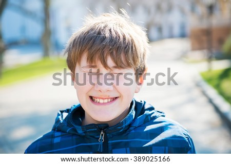 smiling happy boy. spring is coming - stock photo