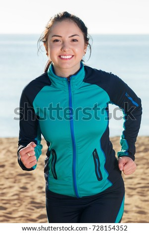 Smiling happy cheerful  woman doing walking training at daytime