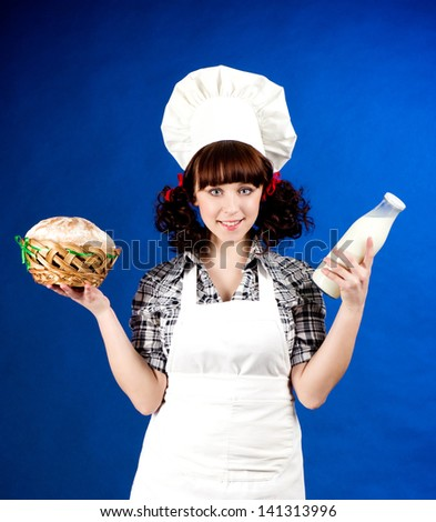 Smiling happy cook woman holds - stock photo