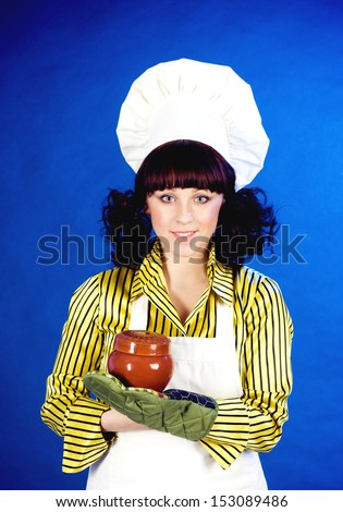 Smiling happy cook woman holds a hot pot - stock photo