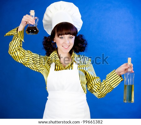 Smiling happy cook woman holds a oils - stock photo