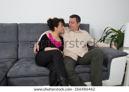 smiling happy couple at home - stock photo