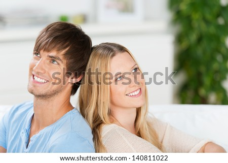 smiling, happy couple looking up and dream - stock photo