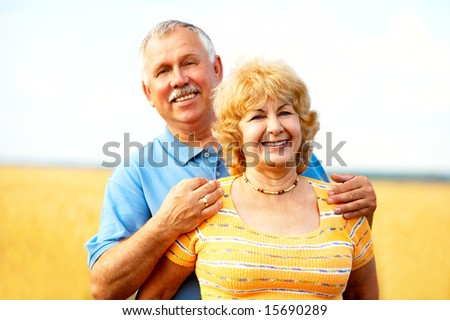 Smiling happy  elderly couple in love outdoor