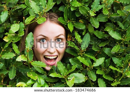 Smiling happy face with plants. Green concept - stock photo