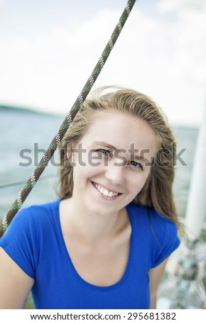 Smiling Happy Female Sailor On Board. Vertical Image Orientation