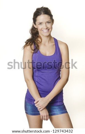Smiling happy fitness young woman - stock photo
