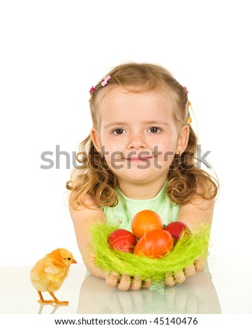 Smiling happy girl with colorful easter eggs - isolated