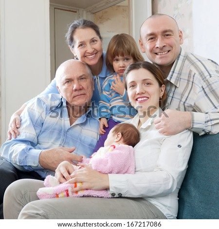 smiling happy three generations family together - stock photo