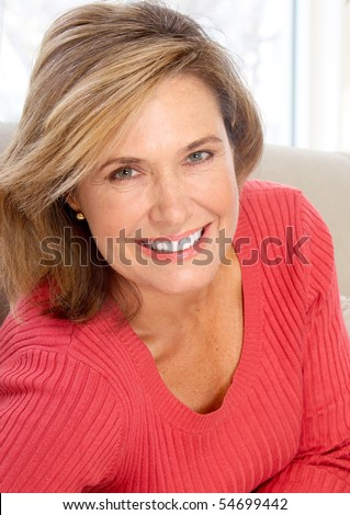 Smiling happy  woman at home - stock photo