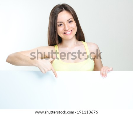 smiling happy woman standing with big blank paper.