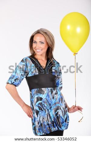 smiling happy woman with Yellow ball - stock photo