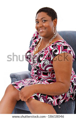 Smiling Happy Young African American Woman Portrait Sitting on Sofa