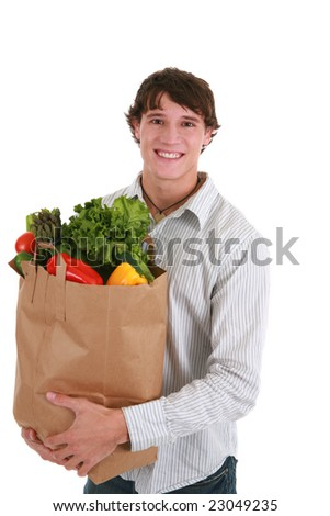 Smiling Healthy Looking Young Man Holding Groceries Paper Bag Isolated - stock photo