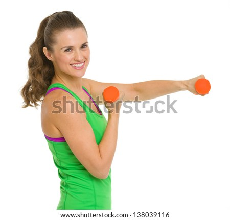 Smiling healthy young woman making exercise with dumbbells