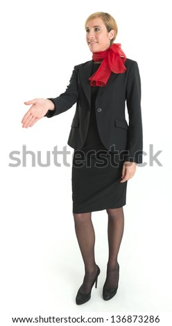 Smiling hostess offering her hand for a handshake - stock photo