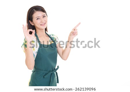 Smiling housewife pointing her side  - stock photo