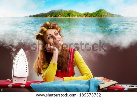 Smiling housewife with ironing-board - stock photo