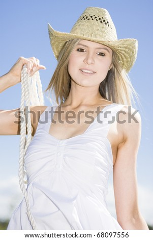 Smiling In Happiness A Happy Farm Woman Holds Rope In A Countryside Portrait - stock photo