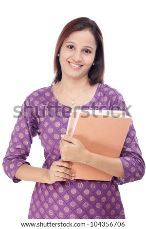 Smiling Indian female student against white - stock photo