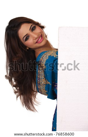 Smiling Indian girl with ad space. Isolated on white background. - stock photo