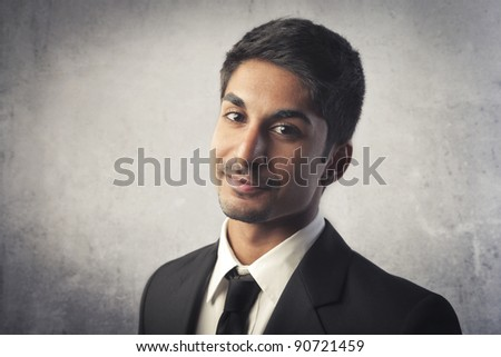 Smiling indian young businessman - stock photo