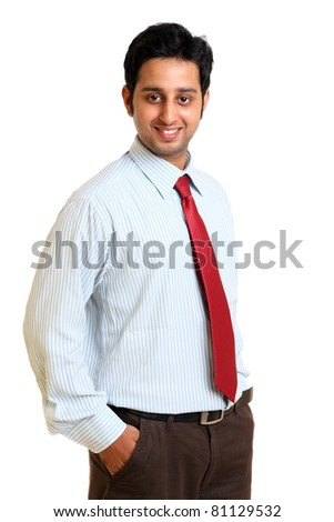 Smiling Indian young businessman on white. - stock photo